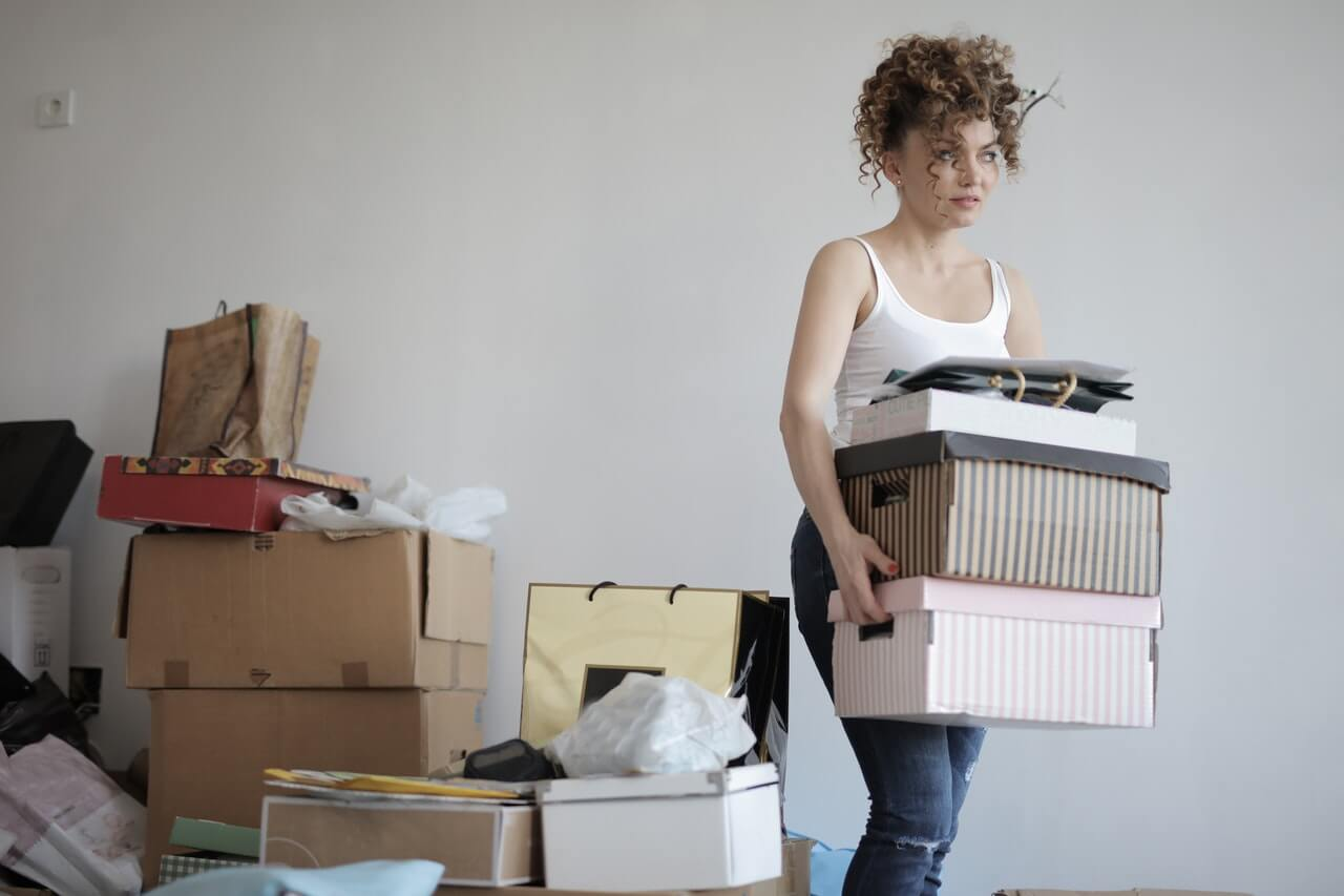 https://www.pexels.com/photo/concentrated-woman-carrying-stack-of-cardboard-boxes-for-relocation-3791617/