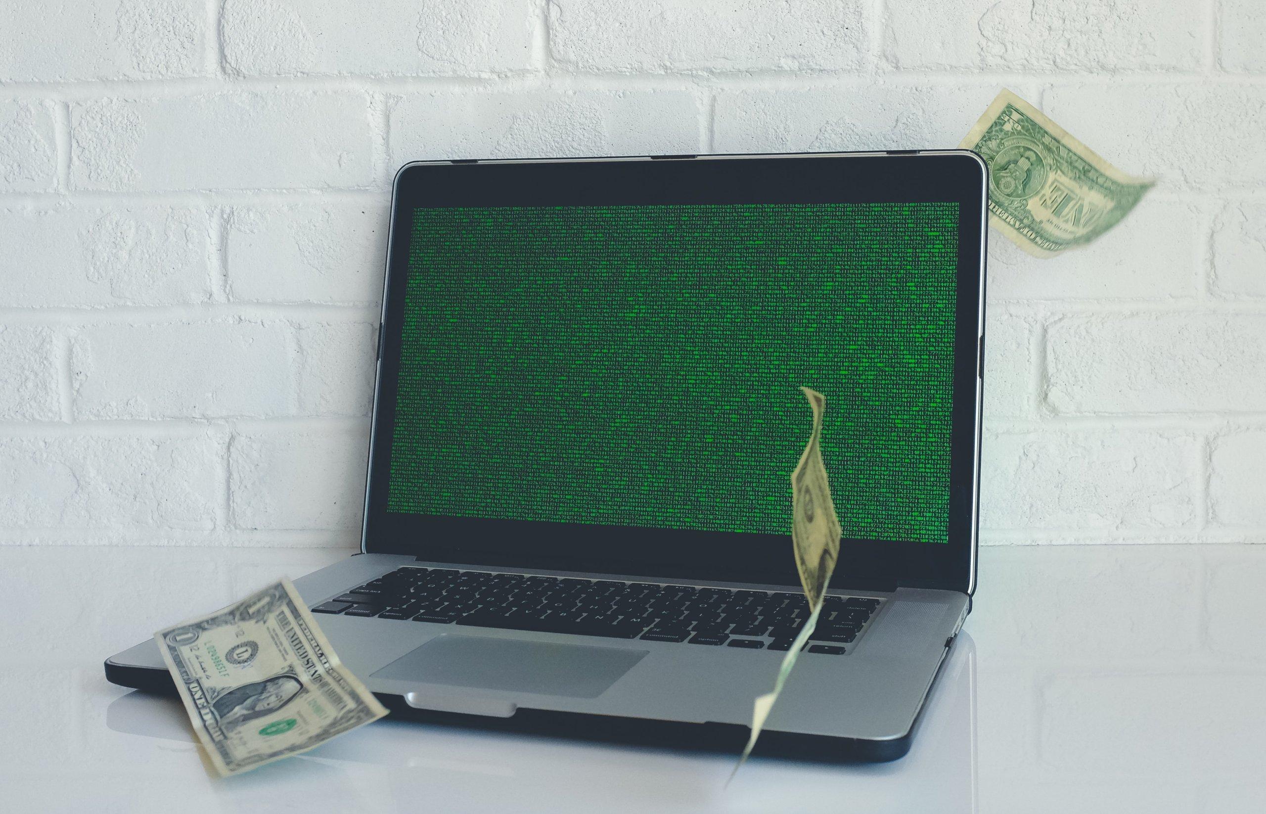 Cash on Laptop