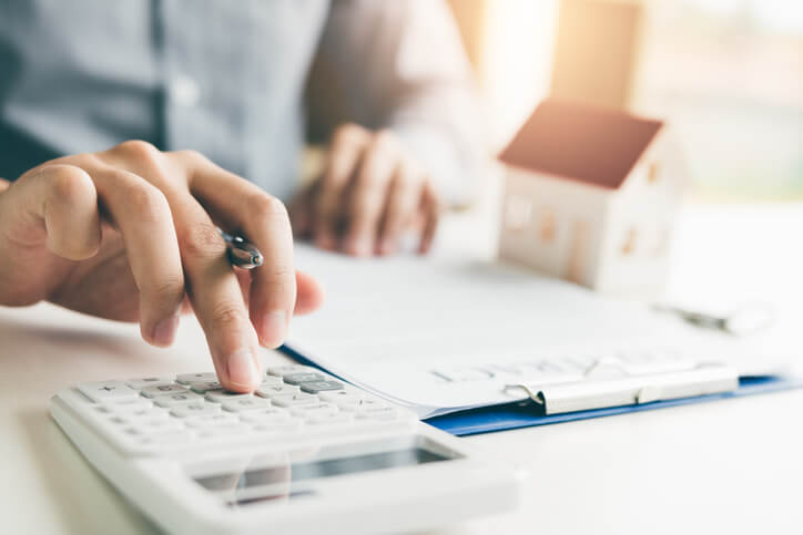 real estate agent calculating numbers