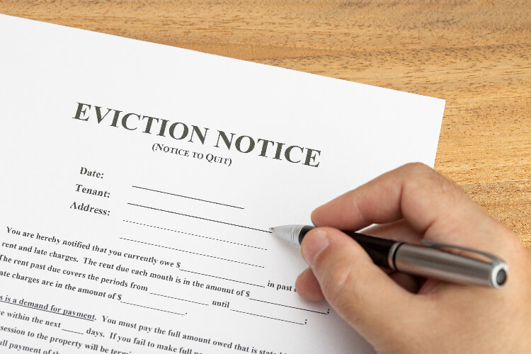person writing eviction notice