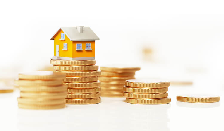small yellow house on coins