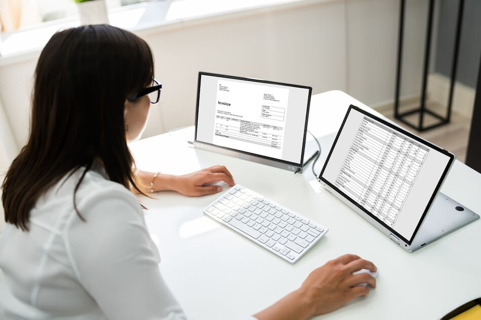 woman looking over spreadsheet